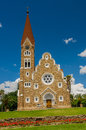 African landscapes windhoek namibia view of the lutheran christ church or christuskirche against blue cloudy sky at Royalty Free Stock Photos