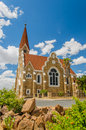 African landscapes windhoek namibia view of the lutheran christ church or christuskirche against blue cloudy sky at Stock Photography