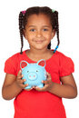 African little girl with a blue piggy-bank Stock Images