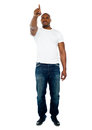 African male pointing his finger at copyspace Royalty Free Stock Photo