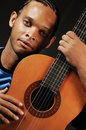 African man with acoustic guitar Royalty Free Stock Image