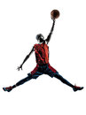 African man basketball player jumping dunking silhouette one in isolated white background Royalty Free Stock Photography