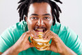 African man eating hamburger Royalty Free Stock Photography