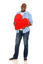 African man heart happy young american holding shape over white background Royalty Free Stock Photography