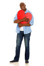 African man hugging heart cheerful american a red shape isolated on white Royalty Free Stock Images