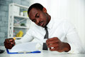 African man reading document in office Royalty Free Stock Photography