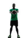 African man soccer player holding showing football silhouette one green jersey in on white background Stock Photos