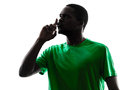 African man soccer player hushing silhouette one green jersey in on white background Stock Photos