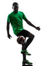 African man soccer player juggling silhouette one green jersey in on white background Stock Photos