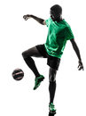 African man soccer player juggling silhouette one green jersey in on white background Royalty Free Stock Images