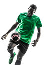 African man soccer player juggling silhouette one green jersey in on white background Royalty Free Stock Photos