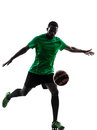 African man soccer player kicking silhouette one green jersey in on white background Stock Photos