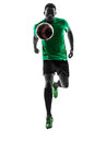 African man soccer player running silhouette one green jersey with football in on white background Royalty Free Stock Photo