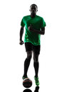 African man soccer player running silhouette one green jersey with football in on white background Stock Photos