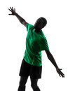 African man soccer player scoring silhouette one green jersey in on white background Stock Photography