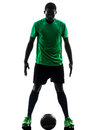 African man soccer player standing silhouette one green jersey in on white background Royalty Free Stock Photos