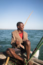 African man stearing a boat near Tofo Royalty Free Stock Photo