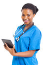 African medical nurse beautiful female american with tablet computer on white Stock Photo