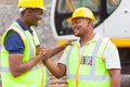 African mine workers cheerful hands together to form brotherhood Stock Image