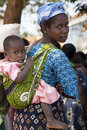 African Mother Carrying Child Stock Photos