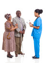 African nurse elderly couple young medical and patient isolated on white background Royalty Free Stock Photo