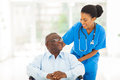 African nurse senior patient beautiful taking care of in wheelchair Royalty Free Stock Image