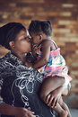 African parent kiss loving mother kissing her baby girl rural real people Stock Photos