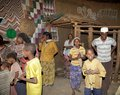 African people at home of the gurage ethnic group inside the tribal hut with traditional drawings the village along the road to Stock Photo