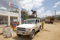 African petrol station cars at the of the national oil company ethiopia the driver is filling the tank with the pump Stock Photography