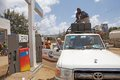 African petrol station man is filling the storage tank on the top of the toyota land cruiser at the national oil company ethiopia Stock Photos