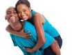 African piggyback ride cheerful women enjoying on boyfriends back isolated on white Stock Photography