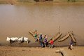 African river tourists have crossed the omo by traditional pirogue near omorate ethiopia Royalty Free Stock Image