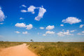 African road with blue sky Royalty Free Stock Photo
