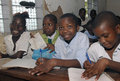 African school children four sitting at their desks in class Royalty Free Stock Photos