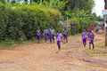 African school children group of on their way home from along a road near moi s bridge kenya Royalty Free Stock Images