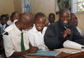 African school children poor in ripped uniforms sitting at their desks in Royalty Free Stock Photos