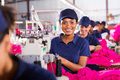 African sewing machinist pretty working in clothing factory Royalty Free Stock Photography