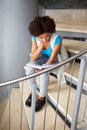 African student girl reading book on stairs Royalty Free Stock Photo