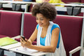 African student girl with smartphone on lecture Royalty Free Stock Photo