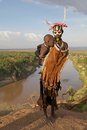 African tribal woman and child with of the karo ethnic group with clothes ornaments body paint omo river in the background Stock Images