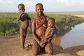 African tribal woman and children with of the karo ethnic group with necklaces omo river in the background ethiopia Royalty Free Stock Photo