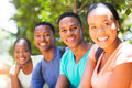 African university students group sitting outdoors Royalty Free Stock Image