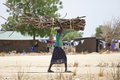 African woman carrying heavy load Royalty Free Stock Photo