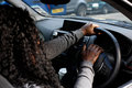 African woman driver honking her horn Royalty Free Stock Photo