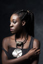African woman with an ethnic necklace looks to the left. Royalty Free Stock Photo