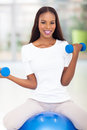 African woman exercising healthy american with dumbbells Stock Photos