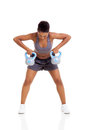 African woman kettle bell young lift weights with both hands on white background Royalty Free Stock Images