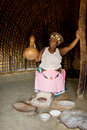 African woman making beer Stock Images