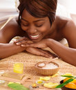African woman on massage table photo of attractive in luxury spa salon smiling female enjoying spa therapy alternative medicine Royalty Free Stock Photos