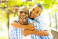 African woman piggyback boyfriend happy women enjoying ride on outdoors Stock Images